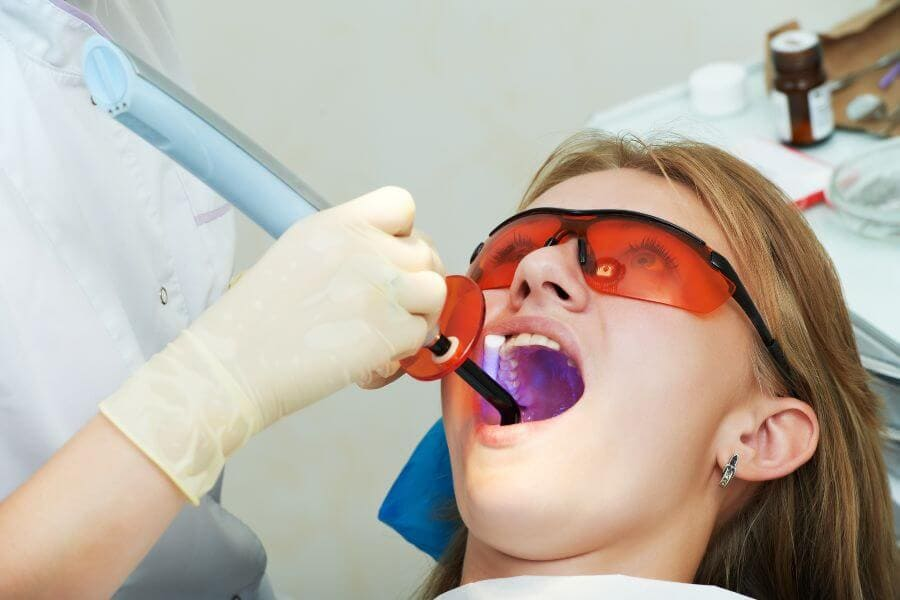 Dentist in Weston Dental filing of child tooth by ultraviolet light